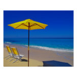 Yellow beach umbrella and chairs on pristine poster