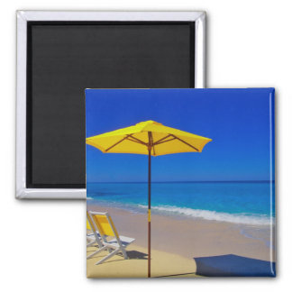 Yellow beach umbrella and chairs on pristine square magnet