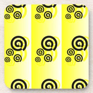 Yellow & black swirls graphic on a coasters