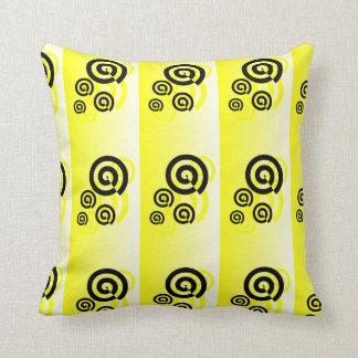 Yellow & black swirls graphic on a pillow