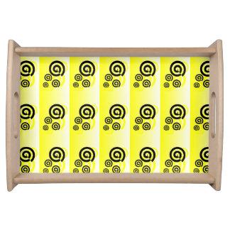 Yellow & black swirls graphic on a tray serving platter