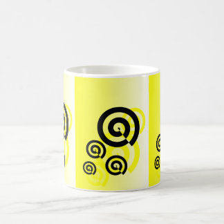 Yellow & black swirls graphic on a white mug