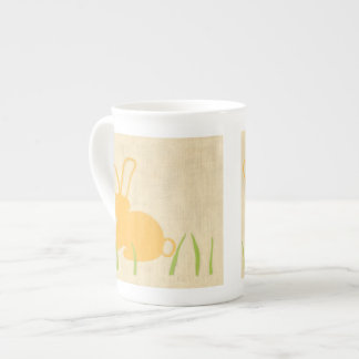 Yellow Bunny and Green Grass by Chariklia Zarris Bone China Mug