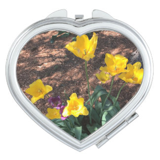 yellow colored tulip type flowers in spring makeup mirrors