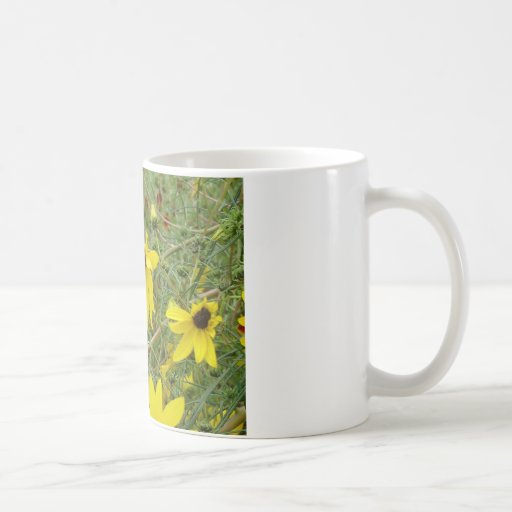 yellow daisy flowers in a field coffee mug