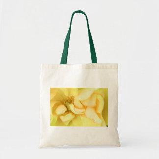 Yellow dancing rose petals tote bag