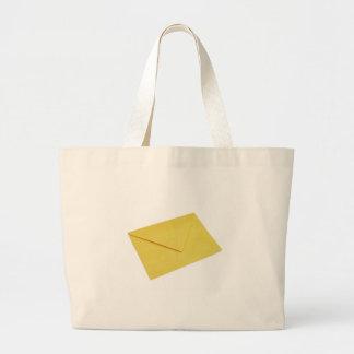 Yellow envelope isolated on white bag