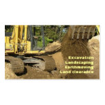 Yellow excavator emptying bucket pack of standard business cards