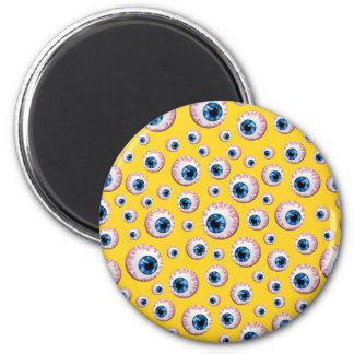 Yellow eyeball pattern fridge magnet