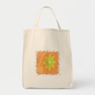 yellow flower on orange grocery tote bag