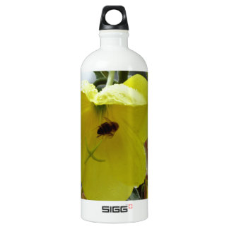 Yellow flowers closeup with water droplets and bee SIGG traveler 1.0L water bottle