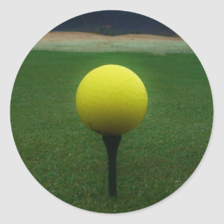 Yellow Golf Ball on a mountain golf course Round Sticker