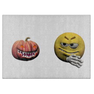 Yellow halloween emoticon or smiley cutting board