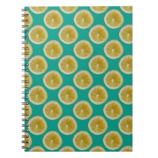 Yellow lemons on blue notebook