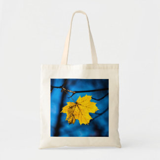 Yellow Maple Leaf On Blue Tote Bag