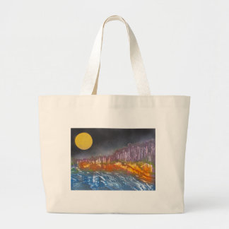 Yellow moon over metamorphic landscape large tote bag