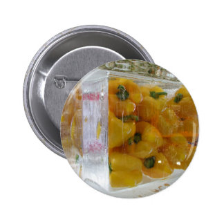 Yellow peppers in ice pinback button