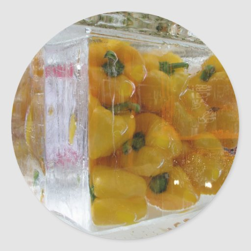 Yellow peppers in ice round sticker