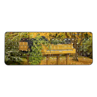 Yellow piano in autumn woods wireless keyboard