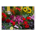 Yellow picket fence with flower garden in greeting card