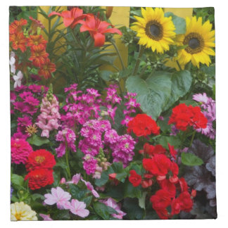 Yellow picket fence with flower garden in printed napkins