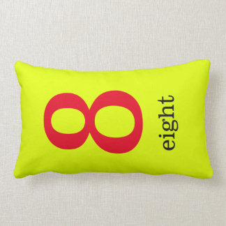 yellow pillow with number eight
