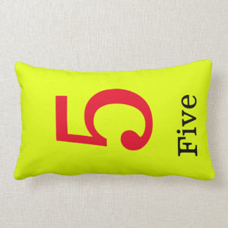 yellow pillow with the number five