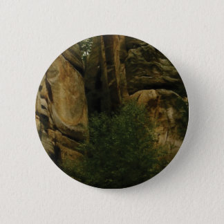 yellow rock face with trees 6 cm round badge