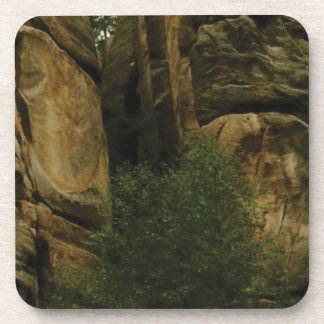 yellow rock face with trees coaster
