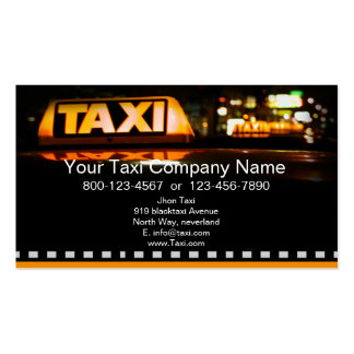 Yellow taxi in black city business card