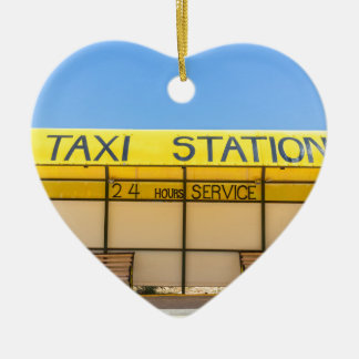 Yellow taxi station at coast in Greece Ceramic Heart Decoration