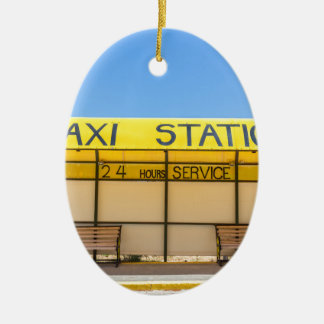 Yellow taxi station at coast in Greece Ceramic Oval Decoration