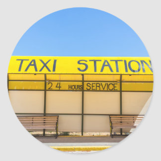 Yellow taxi station at coast in Greece Classic Round Sticker