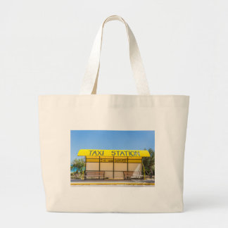 Yellow taxi station at coast in Greece Large Tote Bag