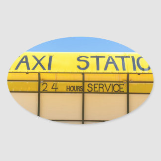 Yellow taxi station at coast in Greece Oval Sticker
