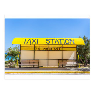 Yellow taxi station at coast in Greece Postcard