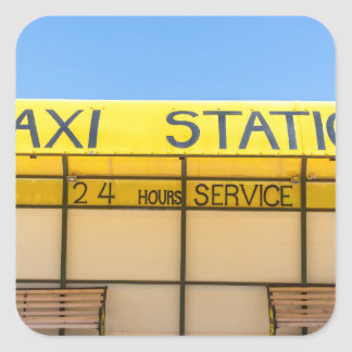 Yellow taxi station at coast in Greece Square Sticker