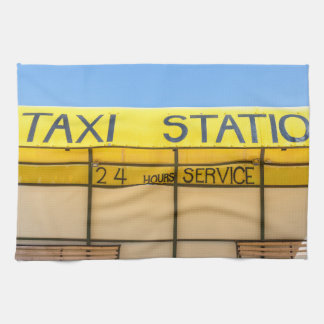 Yellow taxi station at coast in Greece Tea Towel