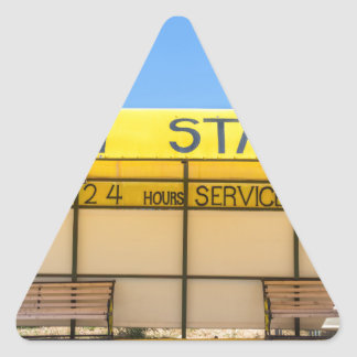 Yellow taxi station at coast in Greece Triangle Sticker