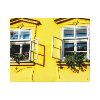 Yellow wall with  open windows canvas print