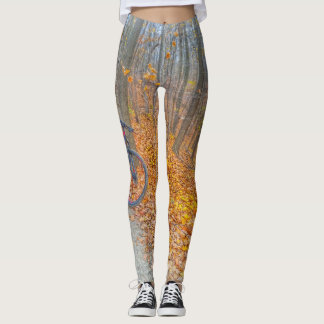 Yoga pants with Mt bike in forest of fallen leaves