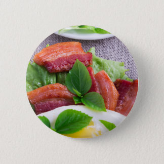 Yolk, fried bacon, herbs and lettuce close-up 6 cm round badge