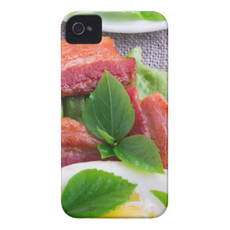 Yolk, fried bacon, herbs and lettuce close-up Case-Mate iPhone 4 cases
