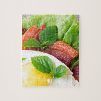 Yolk, fried bacon, herbs and lettuce close-up jigsaw puzzle