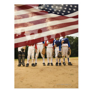 Young baseball players partially hidden by postcard