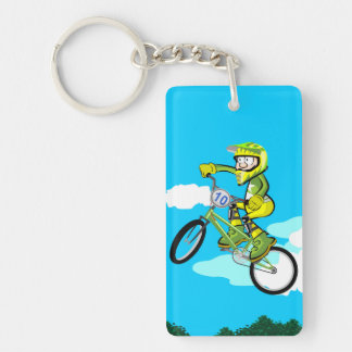 Young BMX giving a turn in the air with its Key Ring