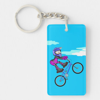 Young BMX jumping in the air stopped in the seat Key Ring