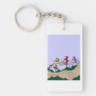 Young BMX lowering the hill with its bicycles Key Ring