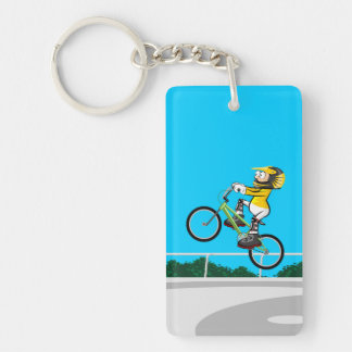 Young BMX taking impulse for makes a pirouette Key Ring