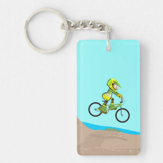 Young BMX with its bicycle in earth track Key Ring